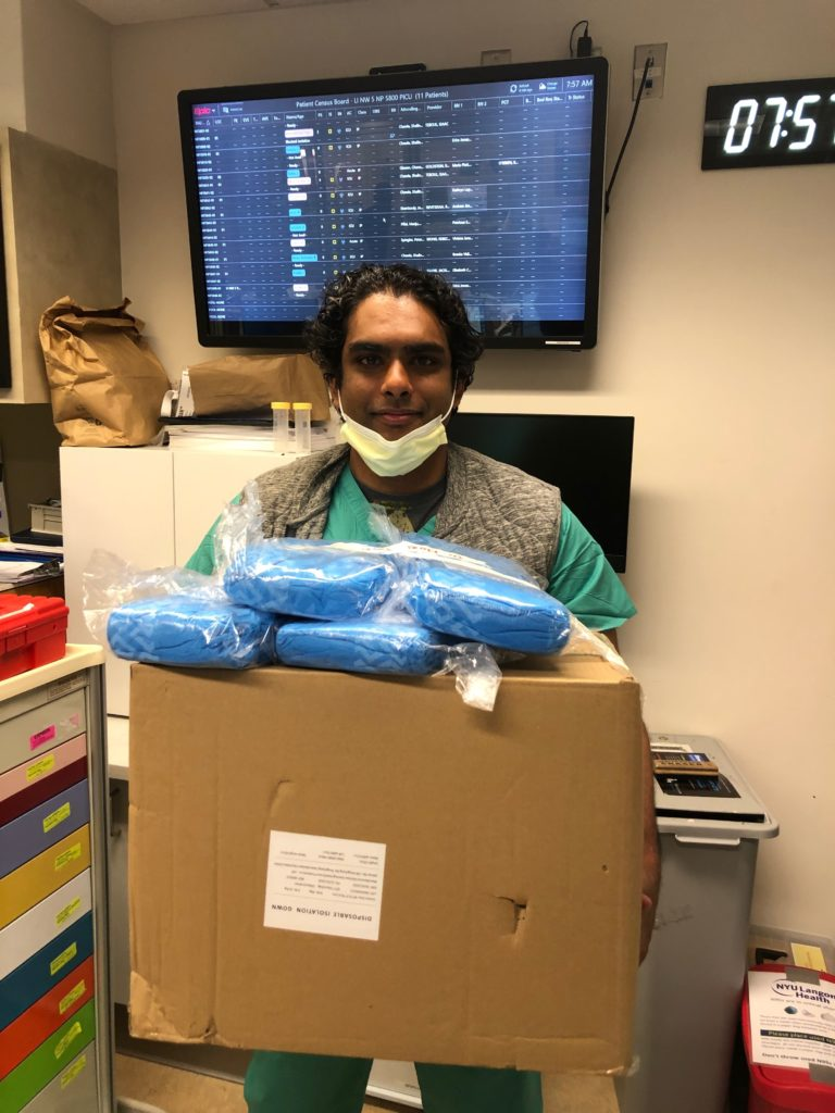 happy healthcare worker with gown delivery